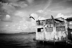 PHOTOGRAPHS BY SEBASTIÁN LISTE Spanish photographer Sebastian Liste's project Urban Quilombo documents his time spent with families living in an abandoned chocolate factory in Salvador de Bahia, Brazil. Able to develop close relationships with the familes and find himself in unexpected circumstances, Liste captures some incredible and powerful images. The project was selected for several awards and he is currently exhibiting the photos at La Galerie de l'Institut français in France.