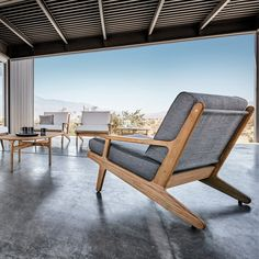 Lounge Chair in buffed finish teak frame with Ferrari sling seat and back panels. Upholstered outdoor fabric seat and back cushions.This lounge chair is part of the Outdoor Bay Lounge collection from Gloster furniture.