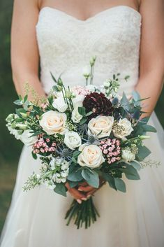 Rustic and elegant barn wedding; bridal bouquet with burgundy dahlia, pale peach roses, pink bouvardia, blue thistle, white lisianthus and eucalyptus; Brett Symes Photography
