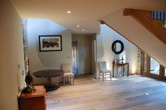 The Barn hallway and entrance with gallery walkway to the two upstairs bedrooms.