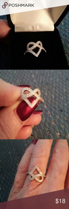 Sterling Silver Heart Ring Size 7 Beautiful sterling silver infinity heart with cubic zirconium accents.  Size 7 Jewelry Rings