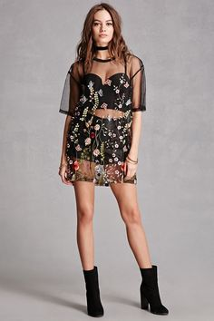 Love this floral sheer embroidered mini dress accessorized with a bustier top and luxe leather shorts.