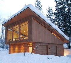Slanted roof over garage -- alternate horizontal and vertical slats to continue division between clerestory and base windows.   Mazama Cabin, FINNE Architects | Remodelista Architect / Designer Directory