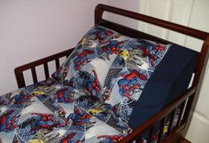 Spiderman Baby/ Toddler Bed Fitted Sheet Set Super Hero Print and Standard Pillowcase Blue. $40.00, via Etsy.