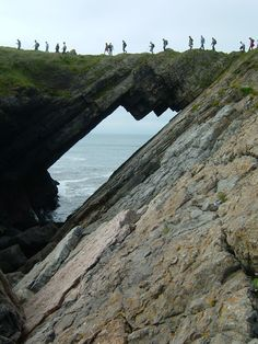 Crossing Devil's Bridge on Worm's Head, Gower, Wales © National Trust