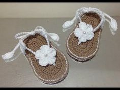 If you are looking for beautiful looking baby booties, look no further. This is so lovely and this is something you can make and is perfect for a 3 to 6 months baby size and perfect as a handmade gift for friends and family. Baby Girl Sandals, Crochet Baby Sandals, Baby Girl Crochet, Crochet Shoes, Crochet Slippers, Knit Crochet, Blanket Crochet, Crochet Flower Tutorial, Crochet Flower Patterns