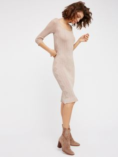 Astrid Pointelle Midi Dress | In an allover metallic this semi-sheer midi dress is featured in a lightweight fabric with ribbed detailing. Scoop back with three-quarter length sleeves, this dress is easily dressed down for day or up for a night out.