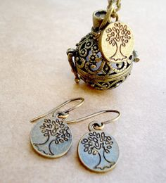 Bronze Filigree Locket Aromatherapy Necklace with Tree of Life Charm and Tree of Life Earrings - Aromatherapy Diffuser - Personal DiffuserBronze Filigree Locket Aromatherapy Necklace with Tree of Life Charm and Tree of Life Earrings - Aromatherapy Diffuser - Personal Diffuser $24.00 USD Quantity  Overview      Handmade item     Materials: Lobster Clasp, Diffuser Charm, Jump Rings, 5 Felt Inserts, Silver Plated Link Chain, Tibetan Silver Charms, Bronze Ear Wires     Feedback: 237 reviews…