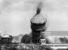 The great tower of Crystal Palace in London falls to the ground during its demolition.