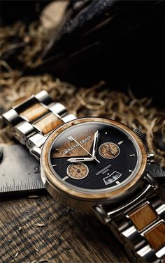 FEATURES  Reclaimed American Oak Whiskey Barrel Wood Brushed Espresso316L Stainless Steel Mineral Crystal Glass Cover Water Resistant (Splash Proof, see FAQ) Japanese Miyota Quartz Movement Double Locking Fold-Over Clasp   CASE  Diameter (including wooden bezel): 47mm  Band  Width: 24mm