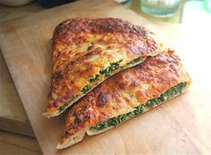 Spinach Ricotta Calzone (coated in tomato sauce and cheese before baked)