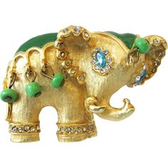 This signed Hattie Carnegie elephant pin looks like it is part of her maharajah series. I also have her snake charmer brooch listed, and they could go Antique Brooches, Antique Jewelry, Vintage Jewelry, Handmade Jewelry, Elephant Jewelry, Animal Jewelry, Vintage Costume Jewelry, Vintage Costumes, High Jewelry