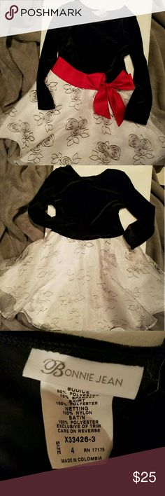 Bonnie Jean Young Girls Elegant Party Dress Size 4 Preloved excellent condition. No stains or pulls. Everyone LOVES this dress! Flares at bottom, black velvet adorned with shiny red bow and a repeat floral pattern on the bottom part of dress. Your daughter will look like a million bucks in this dress! Simply elegant. Bonnie Jean Dresses Formal