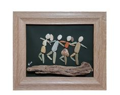 This is a unique pebble art wall hanging that can also stand on any flat surface, made entirely by natural, non-processed materials. It contains pebbles, leaves, driftwood, wood and shells collected by me from the woods and beaches of mount Pelion, near the city of Volos, Greece. Family in the Woods Its dimensions are 40 X 30 cm.