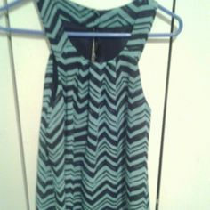 Stylish Turquois Tank Top new condition i never wore the tank top dress style, turqouise with black horizontal lines, opening in the upper back that has 2 small black buttons button A. BYER Tops Tank Tops