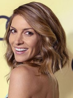 Dawn Olivieri with her Deep-Side-Parted-Messy-Wavy-Sassy-But-NOT-sloppy hairdo.
