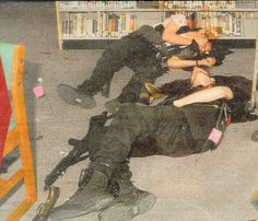 Eric Harris and Dylan Klebold lying dead in the library. The Hi-Point 995 Carbine used in the shooting can be seen next to Klebolds' knee, as well as the sawed-off shotgun at his feet. Columbine High School Massacre, Natural Born Killers, Post Mortem Photography, School Shootings, Criminology, Scene Photo, Interesting History, Cultura Pop, Serial Killers