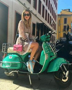 Very cute blonde and her Vespa