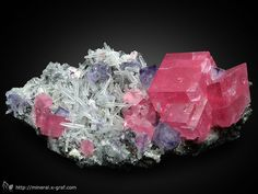 """Rhodochrosite with Minor cubic purple Fluorite and """"needle"""" Quartz crystals on sulfide matrix 