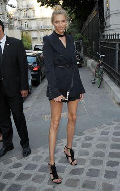 Belted blazer with fringe heels + a topknot.