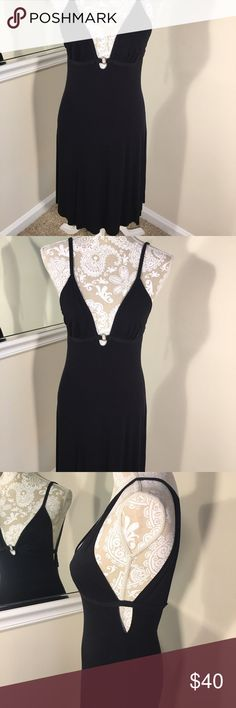 Armani Exchange dress Little black dress by Armani Exchange. Straps with 2 snap buttons in the back. Very low cut and sexy while the length provides a level of class. Key hole sides . Only worn once cannot fit anymore . Very good condition . 96% Rayon 4% spandex . A/X Armani Exchange Dresses Midi