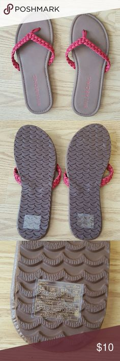 Billabong Braided Flip Flops Billabong braided flip flops brown with pinkish red straps. Brand new with stickers on soles. Never been worn! Thinning out my closet for the season. Smoke and pet free home. All reasonable offers considered. Billabong Shoes Sandals