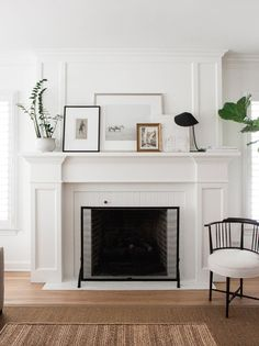 Imagine having this fireplace in your living room! It illustrates a great way to decorate your mantel by stacking/overlapping several pieces of art. We love the elegant, linear lines...and that chair?! So much love for this living room vignette.