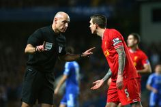 Daniel Agger in discussion with Howard Webb