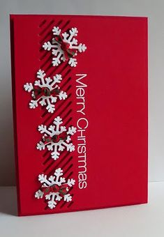Christmas card ... RED! ... luv the punched snowflakes with knotted plaid ribbon ... clean and lovely card ...