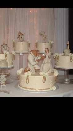 I love how they used the Lenox figurines from Beauty and the Beast on this cake