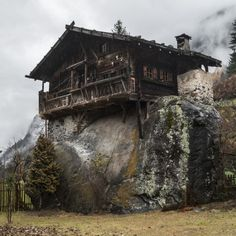 """cabinporn:  """" Val D'Ultimo in South Tyrol, Italy  More than 150 years ago this house was built on ground-level. In 1882, a rogue flood caused by a near stream swept away the surroundings, but the cabin has withstood the flood. Surprisingly a giant rock..."""