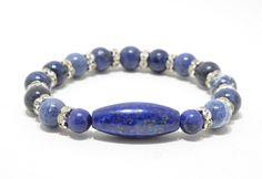 Handmade lapis lazuli stretch bracelet, blue stone bracelet, gemstone jewelry, natural jewelry, beaded bracelet, blue and silver jewelry by houseVNTG on Etsy https://www.etsy.com/listing/215323996/handmade-lapis-lazuli-stretch-bracelet