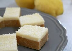 This new and improved Lemon & Coconut Slice recipe is absolutely perfect! Beautiful tangy base topped with a creamy lemon frosting - Thermomix and conventional methods included. Lemon Recipes Baking, Lemon Coconut Slice, Peppermint Slice, Biscuits, Delicious Desserts, Yummy Food, Lemon Frosting, Lunch Box Recipes, Tray Bakes