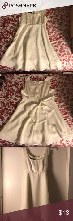 White mini dress w/bow tie for juniors. Pretty dress for special occasions. In good condition. Washed and cleaned. Total length is 30.5 inches. Dress ByChoice California Dresses Mini
