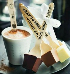 I just LOVE Choc spoons. I guess you can also customise them and put your brand on the stick... Simply serve your customer a mug of hot milk, let them select their flavour chock spoon and .... stir....