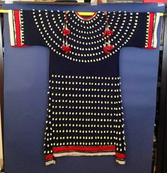 Cowrie shells, pounded brass sequins, silk ribbon on indigo blue stroud cloth 2011 Rhonda Holy Bear Lakota Artist