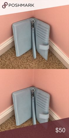 Wristlet Light blue Tory burch wristlet. Excellent condition with plenty of room for cash and credit cards. Zipper compartment for change. Tory Burch Other