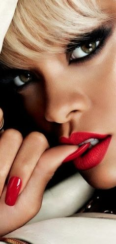 you could try a red lip and do a black lid (eye) then brown shawdow underneath (super easy) then lots of mascara and some eye liner to define!!!!!!!!! va-va-voom ladies!!!!!!!!!!! (match with red nails instead of black)