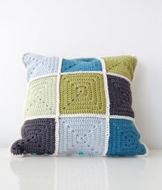 Granny square crochet pillow cover. How pretty are THESE colors? Inspiration only, but looks pretty simple and straightforward with squares crocheted together.