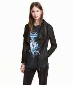 Black. Biker jacket in imitation leather. Diagonal zip at front, ribbed jersey sections under arms, and side pockets. Lined.