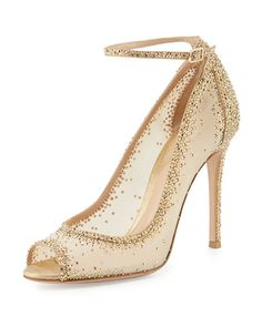 """Gianvito Rossi sheer mesh and leather pump with degrade crystals set throughout. 4.3"""" covered heel. Peep toe. Low-dipped collar. Adjustable ankle-wrap strap. Kid leather lining. Smooth outsole. """"Gemma"""