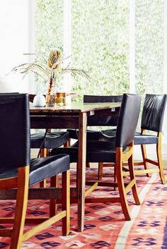 Home Tour: A Rustic California Rental // black leather dining table, flat-weave rug, wooden dining table