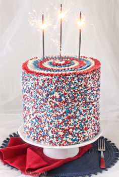 Ridiculously tall red, white, and blue cake for the Fourth of July--with a SURPRISE inside! | From SugarHero.com