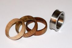 Unique wood turning project idea: Interchangeable wood inlays for stainless steel ring base, from renewablerings.com. Woodturn something different!