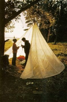Camp under a surplus parachute. ... awesome