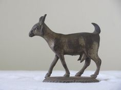 Vintage Goat Cast Iron miniature on a stand: small