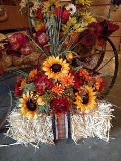 Hay bale fall sunflower arrangement