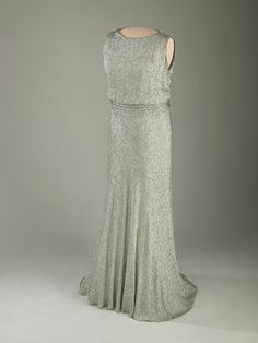 Eleanor Roosevelt's Inaugural Gown, 1933. Slate-blue silk crepe evening gown designed by Sally Milgrim for the 1933 inaugural ball. Embroidered with a leaf-and-flower design in gold thread, it featured detachable long sleeves (not displayed). The belt buckle and shoulder clips are made of rhinestone and moonstone.