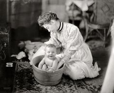 """Circa 1905. """"Martha Harris. Baby being washed."""" Maybe one (or two) of the Harrises of Harris & Ewing. Harris & Ewing glass negative."""
