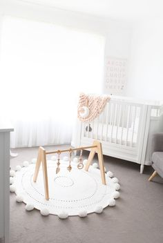 Scandi Nursery with Pink and White. So bright and beautiful with the Modern Monty wooden baby play gym featured. Wooden toys are great as they double as nursery decor and can be a real statement piece!